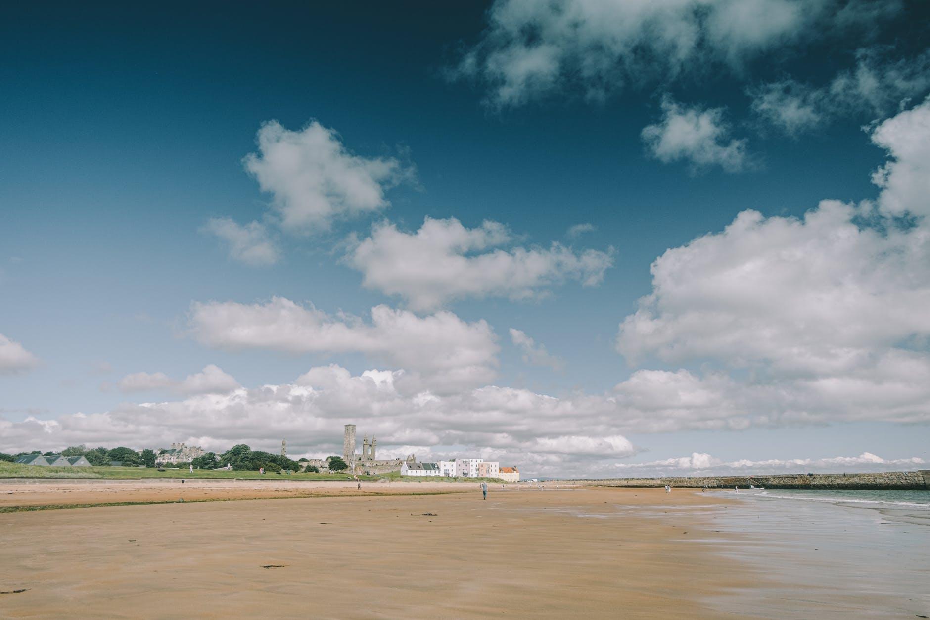 sandy beach near calm river
